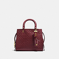 COACH 26839 - ROGUE 25 IN SIGNATURE LEATHER WITH FLORAL BOW PRINT INTERIOR OL/BORDEAUX