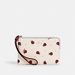 COACH 2970 - CORNER ZIP WRISTLET WITH LADYBUG PRINT SV/CHALK/ RED MULTI