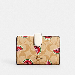 COACH 3152 - MEDIUM CORNER ZIP WALLET IN SIGNATURE CANVAS WITH WATERMELON PRINT IM/LT KHAKI/RED MULTI