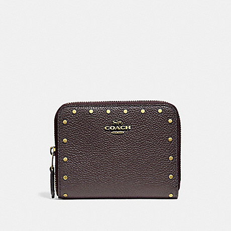 COACH SMALL ZIP AROUND WALLET WITH RIVETS - BRASS/OXBLOOD - 31811
