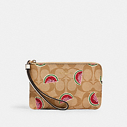 CORNER ZIP WRISTLET IN SIGNATURE CANVAS WITH WATERMELON PRINT - 3281 - IM/LT KHAKI/RED MULTI