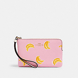 COACH 3285 - CORNER ZIP WRISTLET WITH BANANA PRINT IM/PINK LEMONADE MULTI