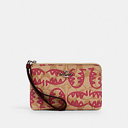 COACH 4406 - CORNER ZIP WRISTLET IN SIGNATURE CANVAS WITH REXY BY GUANG YU SV/LT KHAKI/ELCTRC PINK MULTI