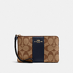 COACH 58035 - CORNER ZIP WRISTLET IN SIGNATURE CANVAS IM/KHAKI MIDNIGHT