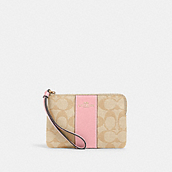 COACH 58035 - CORNER ZIP WRISTLET IN SIGNATURE CANVAS IM/LIGHT KHAKI/BUBBLEGUM