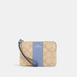 CORNER ZIP WRISTLET IN SIGNATURE CANVAS - SV/LIGHT KHAKI PERIWINKLE - COACH 58035
