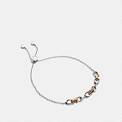 COACH 5976 - LINKED SIGNATURE SLIDER BRACELET SILVER/GOLD