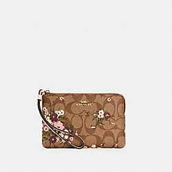 CORNER ZIP WRISTLET IN SIGNATURE CANVAS WITH EVERGREEN FLORAL PRINT - IM/KHAKI MULTI - COACH 6860