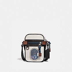 COACH 69307 - DYLAN 10 WITH COACH PATCH CHALK/BLACK/BLACK COPPER