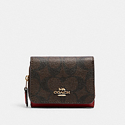 COACH 7331 - SMALL TRIFOLD WALLET IN SIGNATURE CANVAS IM/BROWN 1941 RED