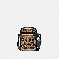 COACH 75762 Dylan 10 In Signature Canvas With Rexy By Guang Yu KHAKI/BLACK COPPER