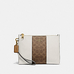 COACH 78372 - CHARLIE POUCH WITH SIGNATURE CANVAS BLOCKING BEIGE