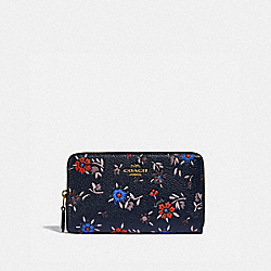 MEDIUM ZIP AROUND WALLET WITH WILDFLOWER PRINT - 828 - BRASS/MIDNIGHT NAVY MULTI