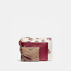 COACH 86399 - TRIPLE POUCH IN SIGNATURE CANVAS AND FLORAL PRINT BRASS/TAN DEEP RED MULTI