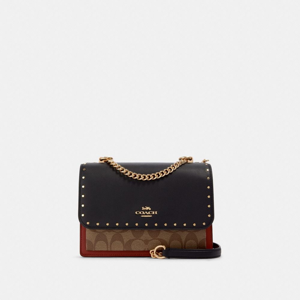 KLARE CROSSBODY IN SIGNATURE CANVAS WITH RIVETS