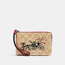 COACH 91075 Corner Zip Wristlet In Signature Canvas With Horse And Carriage Hearts Motif SV/LIGHT KHAKI MULTI/POPPY