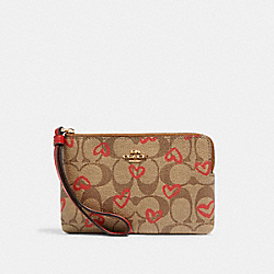 COACH 91076 Corner Zip Wristlet In Signature Canvas With Crayon Hearts Print IM/KHAKI RED MULTI