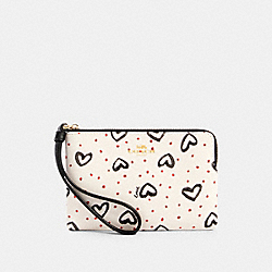 COACH 91078 Corner Zip Wristlet With Crayon Hearts Print IM/CHALK PINK MULTI/BLACK