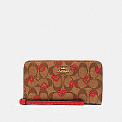COACH 91578 Large Phone Wallet In Signature Canvas With Crayon Hearts Print IM/KHAKI RED MULTI
