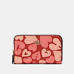 MEDIUM ZIP AROUND WALLET WITH COACH HEART PRINT - 91594 - IM/JASPER MULTI