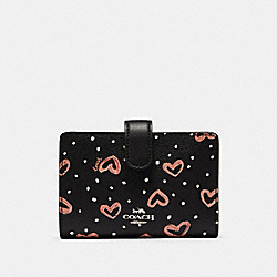 COACH 91599 - MEDIUM CORNER ZIP WALLET WITH CRAYON HEARTS PRINT SV/BLACK PINK MULTI