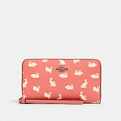 COACH 91830 Large Phone Wallet With Bunny Script Print SV/BRIGHT CORAL
