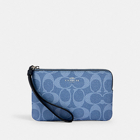 COACH 92632 CORNER ZIP WRISTLET IN SIGNATURE CANVAS SV/LIGHT DENIM