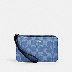 CORNER ZIP WRISTLET IN SIGNATURE CANVAS - 92632 - SV/LIGHT DENIM