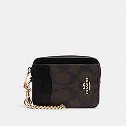 COACH C0058 Zip Card Case In Signature Canvas IM/BROWN BLACK