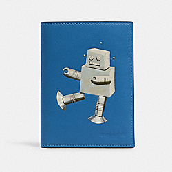 COACH C1612 - PASSPORT CASE IN SIGNATURE CANVAS WITH ROBOT QB/BLUE JAY MULTI