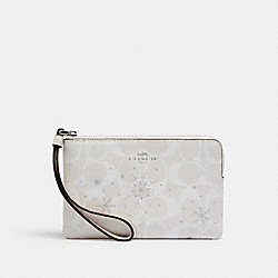 COACH C1862 - CORNER ZIP WRISTLET IN SIGNATURE CANVAS WITH SNOWFLAKE PRINT SV/CHALK MULTI
