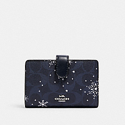 COACH C1927 - MEDIUM CORNER ZIP WALLET IN SIGNATURE CANVAS WITH SNOWFLAKE PRINT SV/MIDNIGHT MULTI