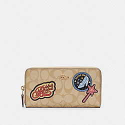 DISNEY X COACH ACCORDION ZIP WALLET IN SIGNATURE CANVAS WITH PATCHES - IM/LIGHT KHAKI MULTI - COACH C1946