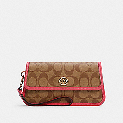 COACH ORIGINALS WRISTLET IN SIGNATURE CANVAS - IM/KHAKI/FUCHSIA - COACH C2299