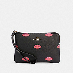 COACH C3337 - CORNER ZIP WRISTLET WITH LIPS PRINT IM/BLACK MULTI