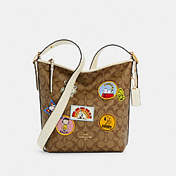 COACH X PEANUTS VAL DUFFLE IN SIGNATURE CANVAS WITH VARSITY PATCHES - C4112 - IM/KHAKI CHALK MULTI