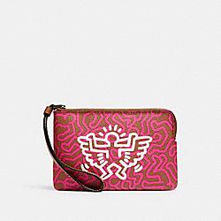 COACH F11831 Keith Haring Corner Zip Wristlet With Graphic Print QB/BRIGHT FUCHSIA SADDLE