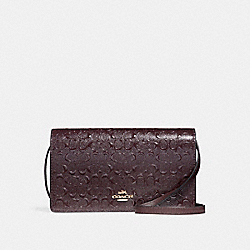 FOLDOVER CROSSBODY CLUTCH IN SIGNATURE DEBOSSED PATENT LEATHER - f15620 - LIGHT GOLD/OXBLOOD 1