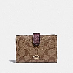 COACH F23553 - MEDIUM CORNER ZIP WALLET IN SIGNATURE CANVAS KHAKI/METALLIC RASPBERRY/LIGHT GOLD