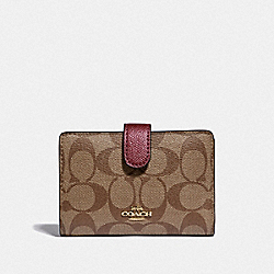 COACH F23553 - MEDIUM CORNER ZIP WALLET IN SIGNATURE CANVAS IM/KHAKI METALLIC WINE