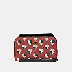 COACH PHONE WALLET WITH CHECKER HEART PRINT - TERRACOTTA MULTI/LIGHT GOLD - F25963