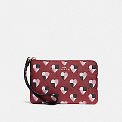 CORNER ZIP WRISTLET WITH CHECKER HEART PRINT - f26614 - TERRACOTTA MULTI/LIGHT GOLD