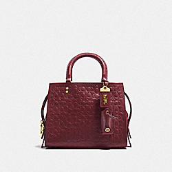 COACH F26839 - ROGUE 25 IN SIGNATURE LEATHER WITH FLORAL BOW PRINT INTERIOR BORDEAUX/OLD BRASS