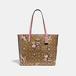REVERSIBLE CITY ZIP TOTE IN SIGNATURE CANVAS WITH FLORAL BUNDLE PRINT - f29547 - khaki/multi/imitation gold