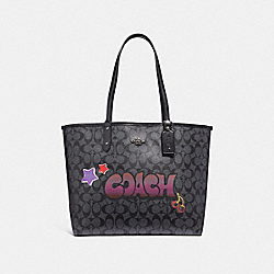 REVERSIBLE CITY TOTE IN SIGNATURE CANVAS WITH GRAFFITI - f31500 - black smoke multi/black antique nickel