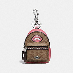 BACKPACK COIN CASE IN SIGNATURE CANVAS WITH LIPS - f31888 - KHAKI MULTI /SILVER