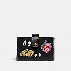 DISNEY X COACH ACCORDION CARD CASE WITH SPOOKY EYES PRINT - F33055 - BLACK