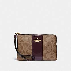 CORNER ZIP WRISTLET IN SIGNATURE CANVAS - f34650 - KHAKI/OXBLOOD/light gold