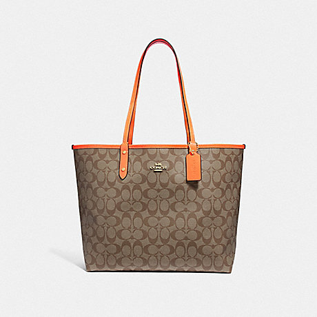 COACH F36658 REVERSIBLE CITY TOTE IN SIGNATURE CANVAS<br>蔻驰可逆城市。签名画布 卡其色和橙色霓虹灯/浅黄金