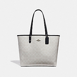 REVERSIBLE CITY TOTE IN SIGNATURE CANVAS - f36658 - chalk/midnight/silver